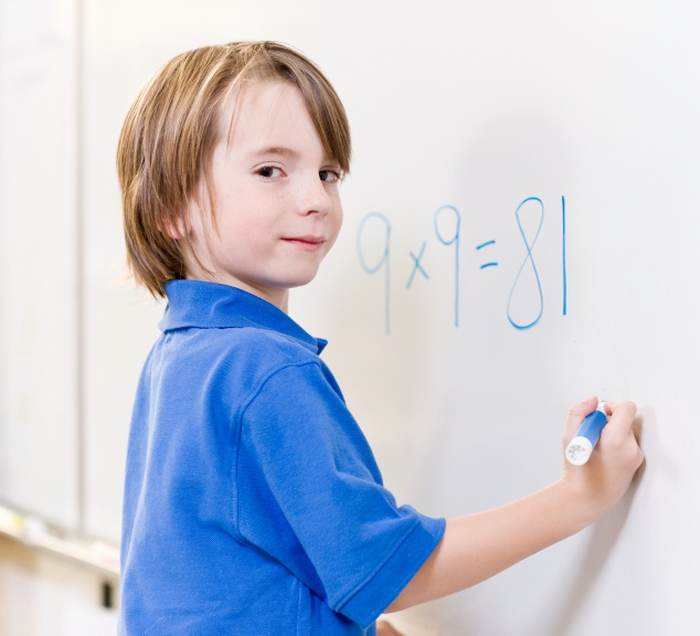 child_writing_numbers_on_whiteboard